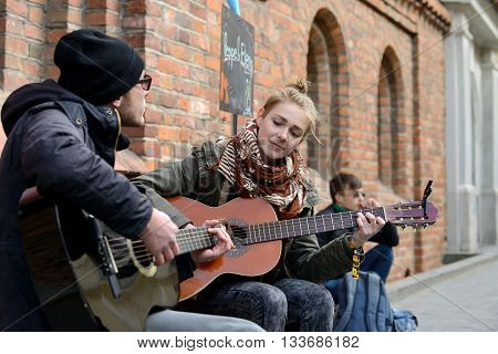 VILNIUS LITHUANIA - MAY 16: Unidentified musician plays guitar in Street Music Day on May 16 2015 in Vilnius. Its a most popular event on May in Vilnius Lithuania