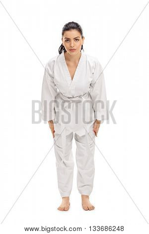 Vertical shot of a female martial artist bow down and greeting someone isolated on white background