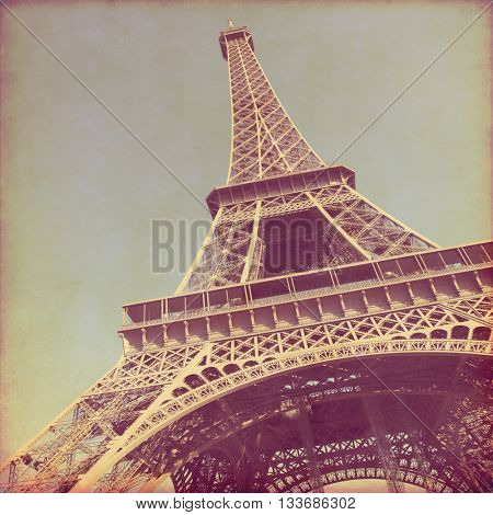 View of Eiffel Tower in Paris. Old style photo.