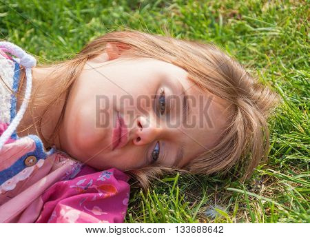 Portrait of a cute sad lonely little girl