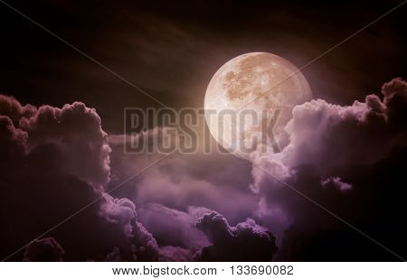 Attractive photo of a nighttime sky with clouds bright full moon would make a great background. Beauty of nature. Vintage tone. The moon taken with my own camera no NASA images used.