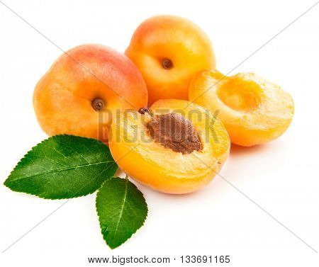 Fresh apricots in section with green leaves still life of ripe fruits isolated white background