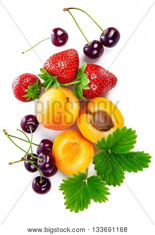 Fresh berries and fruits in still life top view with green leaves strawberry apricot cherry isolated on white background