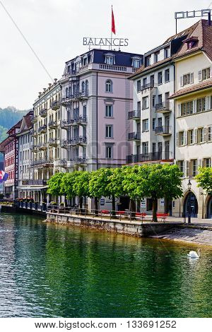LUCERNE SWITZERLAND - MAY 02 2016: Colorful buildings along the river shows unique character of the Old Town and it looks to be tuned with modern times and offers variety of sightseeing attractions