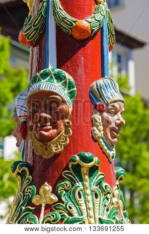 LUCERNE SWITZERLAND - MAY 06 2016: Colorful grotesque figures it is a detail on a pillar of Fritschi Fountain in Gothic style. A variety of fountains is a great tourist attraction in the City