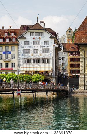LUCERNE SWITZERLAND - MAY 02 2016:View towards the decorated buildings shows unique character of the Old Town and it looks to be tuned with modern times and offers variety of sightseeing attractions
