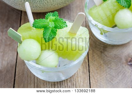 Homemade melon popsicles in the glass closeup