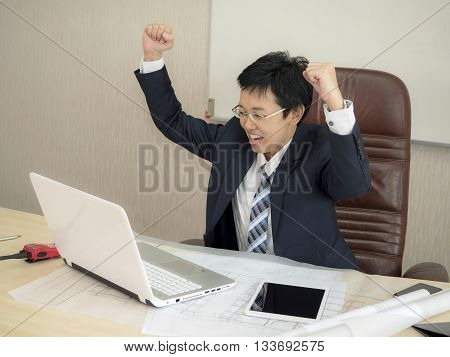 SMART Business woman feel glad / happy / success in front of laptop in the working room (Success business concept)