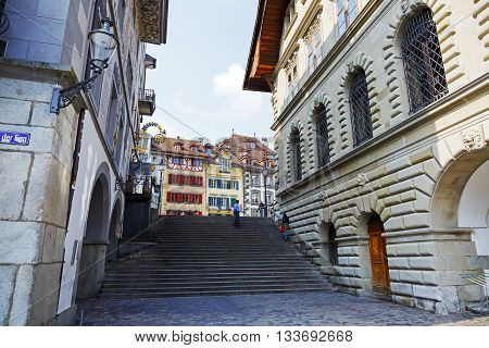 LUCERNE SWITZERLAND - MAY 02 2016: View towards colorful buildings at the square in the old town. This square is called Kornmarkt and offers variety of sightseeing attractions