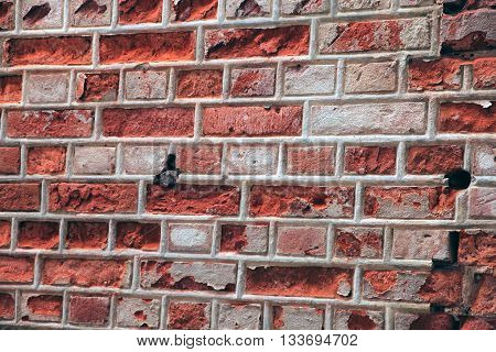 old ruined red brick russian masonry with thick white joints