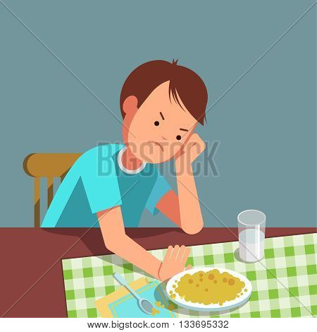 A little boy refusing food kid does not want to eat. The boy sits at the table and does not want to eating