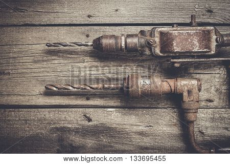 retro hand drills on the wooden table
