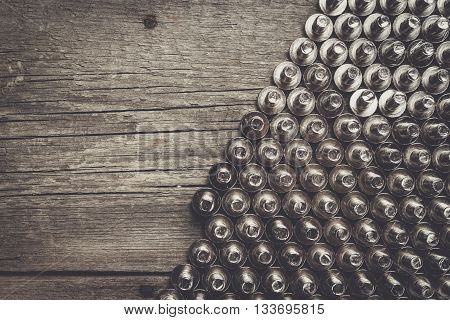 new bolts on the wooden table background