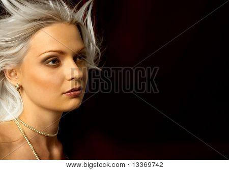 Pretty woman on dark background