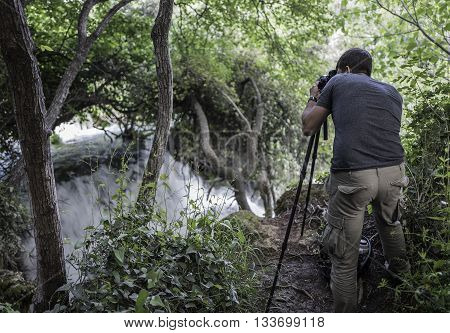 Photographer is making picture of wonderful waterfalls