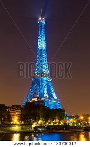 paris; France-June 09 2016 : The Eiffel tower lit up in blue color for opening of soccer Europe championship 2016 in France. The Eiffel tower is on of the most visited monuments in the world.