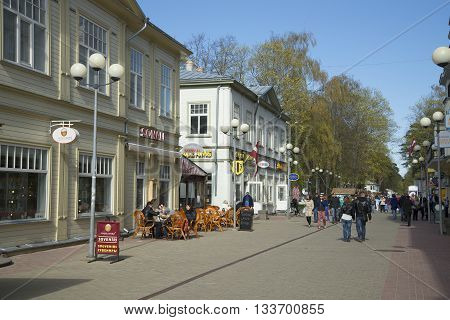 JURMALA, LATVIA - MAY 02, 2014:Tourists walk through the streets of Jurmala, may day
