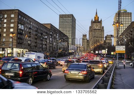 MOSCOW, RUSSIA - APRIL 4, 2015: Heavy evening traffic on Smolenskaya Street with the Ministry of Foreign Affairs building in the backdrop in Moscow, Russia