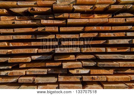 Stored sawn pine boards rural spring  day