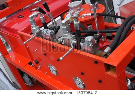 Hydraulic tubes fittings and levers on control panel of mechanism
