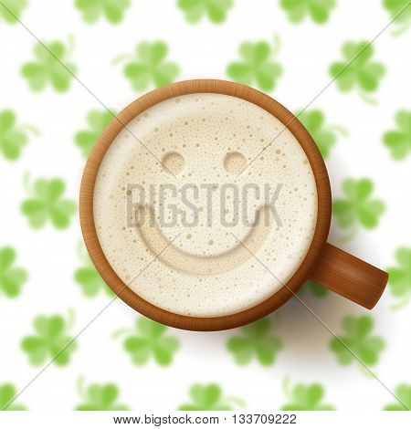 Mug of beer with smiling face on frothy top on green background with clover leaves. St. Patrick's Day and good mood concept