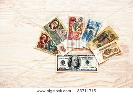 Hai, Ukraine - Circa May,2016: Set Of Bill Ussr Roubles Money With 100 Dollar On Wooden Background.