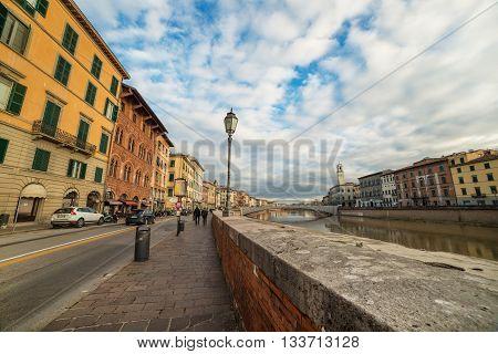 Pisa, Italy - circa September of 2012: Lungarno Antonio Pacinotti street, View on Arno river
