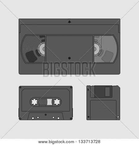 Videocassette, compact cassette and floppy disk. Retro storage devices. Outdated technology concept. Black and white image