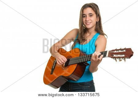 Teenage girl playing an acoustic guitar - Isolated on a white background