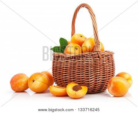 Fresh apricot with green leaf in wicker basket still life of fruits isolated on white background and copyspace