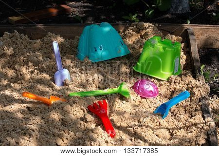 a children's toys are in the sandbox