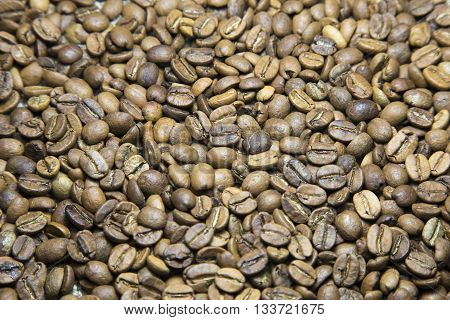 A coffee mug of coffee beans. coffee beans background