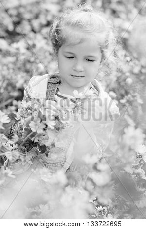 Spring portrait of a little girl in flowers ( black and white )