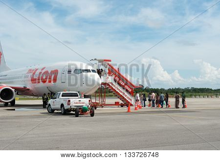 NAKHON SI TAMMARATTHAILAND-JAN 18 2016 :Passengers waiting to board plane on the runway of the airport in Nakhon Si Thammarat on 18 january 2016 thailand