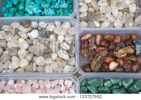 Closeup of various colorful stones quartz, marbles, ore minerals, gems