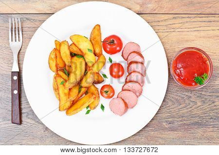 Fried Potato Wedges in a Rural and Sausage Studio Photo