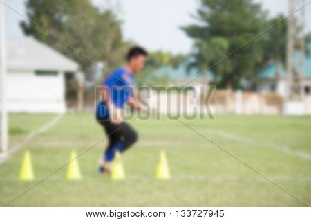 blurry Goalkeeper in action playing football (soccer)
