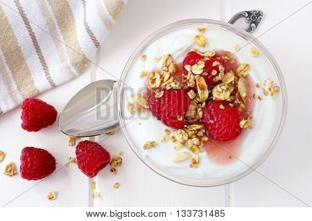 Raspberry Flavored Greek Yogurt With Granola, Overhead View With Spoon On White Wood