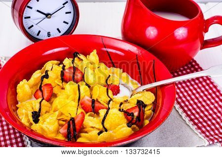 Cornflakes with Strawberry and Chocolate. Healthy Breakfast Studio Photo