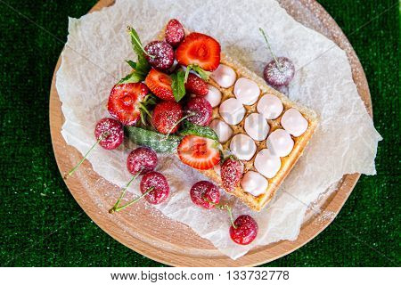 Plate Of Belgian Waffles With Ice Cream, Caramel Sauce And Fresh Fruit