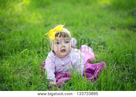 Cute Baby Girl On Green Grass