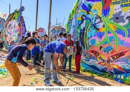 Sumpango Guatemala - November 1 2015: Locals tie together bamboo framework to make handmade kite at giant kite festival on All Saints' Day honoring spirits of dead.