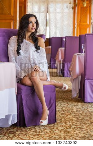Fashion model posing in a restaurant environment