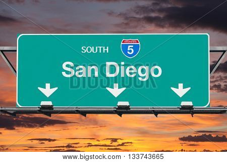 San Diego Interstate 5 south highway sign with sunrise sky.