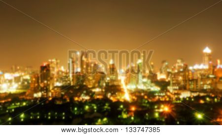 Defocus and blur image of building and natural park at night. Blurred building and city at night. Night light in the city. Bangkok night Thailand.