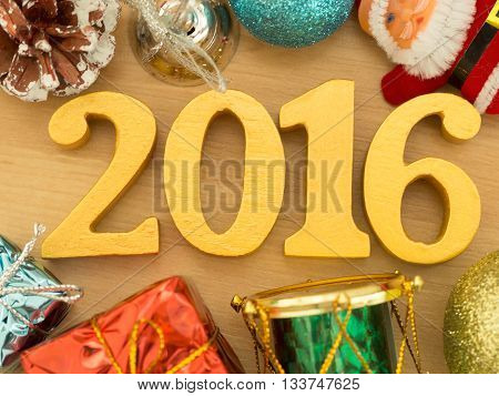 Text of gold 2016 make from wood. Golden year 2016. New year decoration closeup on 2016 text. Happy new year 2016.