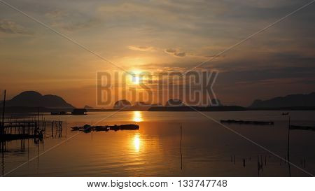 Landscape of nature sunrise/ sunset in the sea at Samchong fishing village in Phang-Nga Thailand