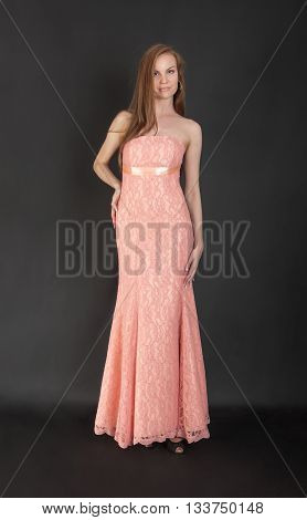 slim pretty girl in a pink evening dress