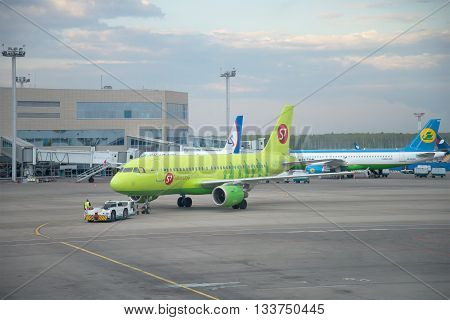 MOSCOW, RUSSIA - MAY 03, 2016: Towing aircraft Airbus A319 (VP-BTV) on the runway. Domodedovo airport