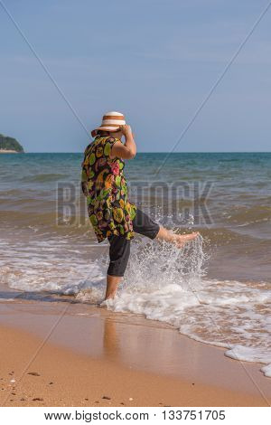 Asia Woman Posing At Beach With Blue Sea And Sky